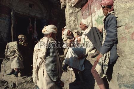 men gossiping in the souk jibla