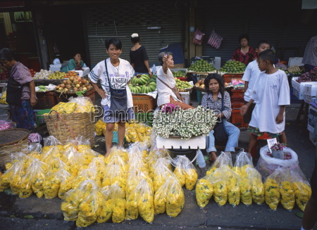 women selling flowers and fruit from