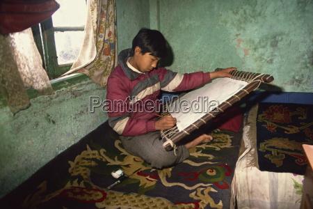 portrait of a young tibetan thangka