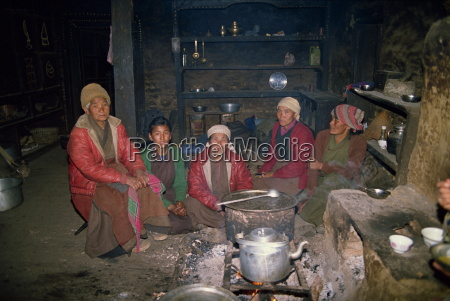 a group of sherpa women indoors