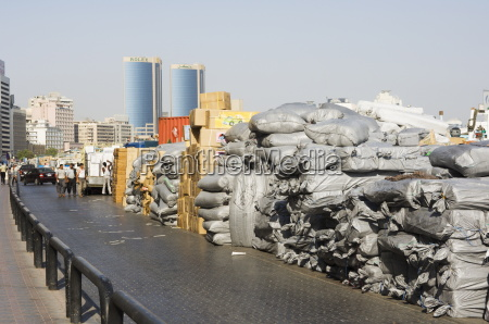goods stacked on the dockside of