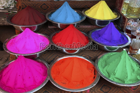 colorful herbal powders in the market