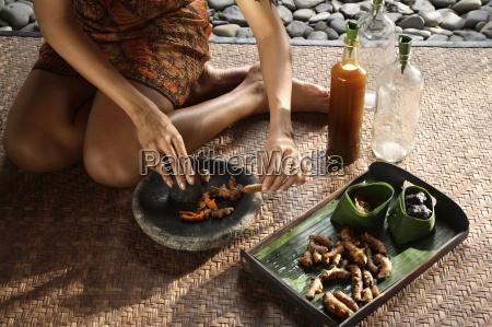 preparing jamu a herbal elixir bali