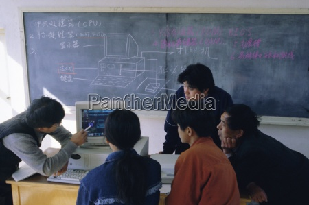 students at a computer demonstration in