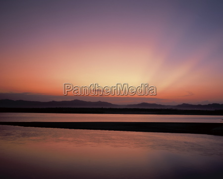 sunset on the irawaddy river bagan