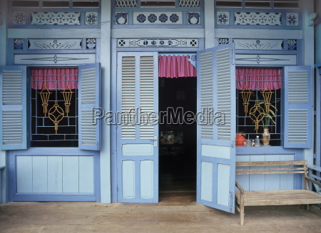 front of a vietnamese house on
