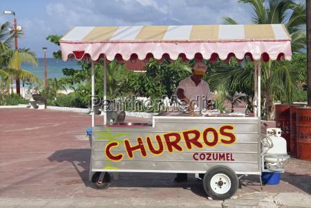 a churros seller at playa del