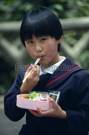 school girl eating her lunch with