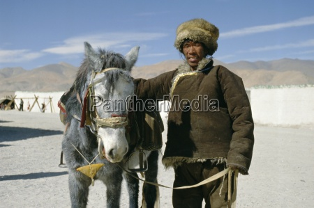 tibetan horseman with his horse tibet
