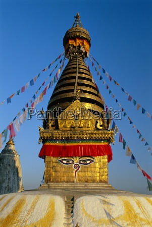 spire and prayer flags of the