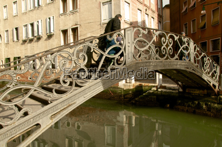 exceptional metal bridge over canal with