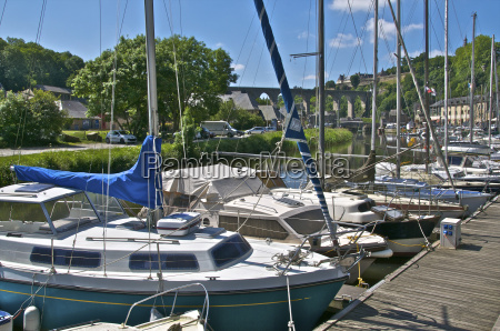 sailboats moored on river rance with