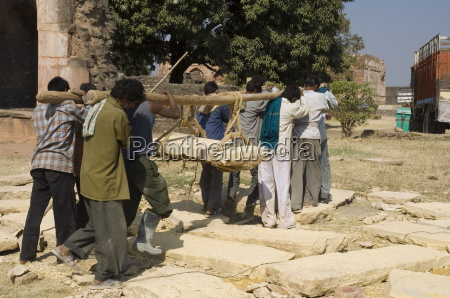 lifting by hand heavy stones for