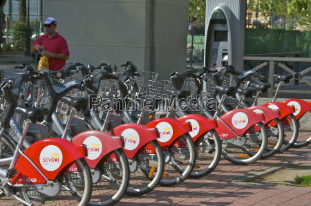 parked red bikes for hire seville