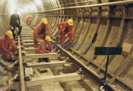 london transport workers installing track in