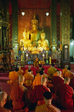 monks seated inside temple wat phra