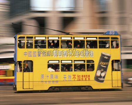 tram in motion causeway bay hong