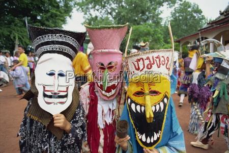 portrait of people wearing masks of