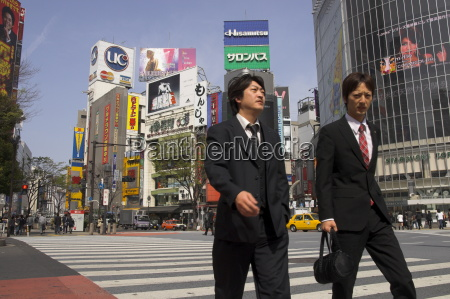 two well dressed young men walking