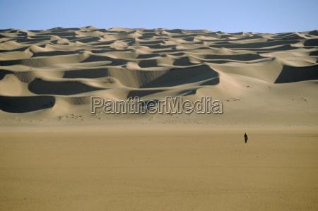 sahara desert with lone figure in