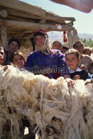 woman proud of her dried wool