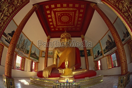 giant seated buddha statue covered in