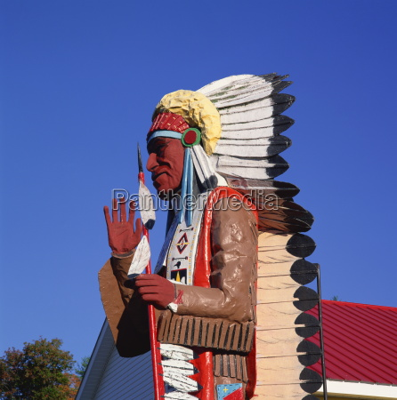 carving of native american mohawk trail