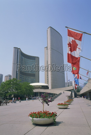 flags outside the modern buildings of