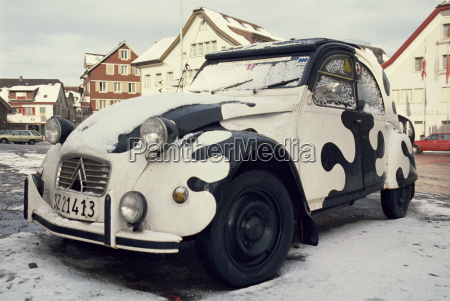 2cv car painted crazy cow covered