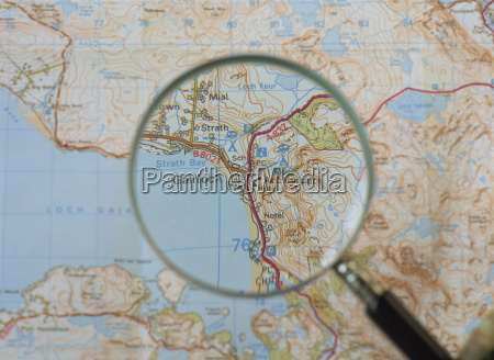 magnifying glass above an ordnance survey