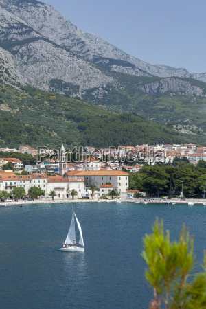 makarska harbour with yacht and mountains