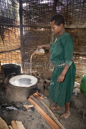 woman making injera the staple diet
