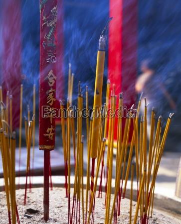 close up of incense sticks burning