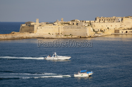 fort ricasoli from valletta with yacht