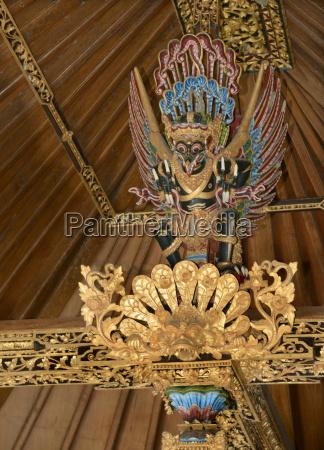 garuda image above the bed beams