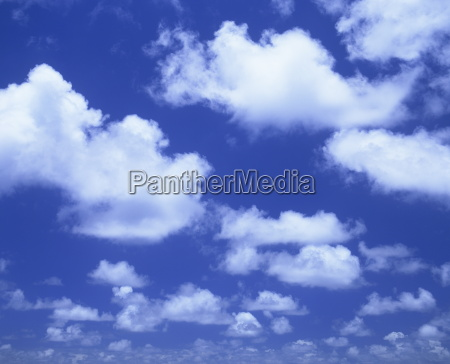 blue sky with puffy white cumulus