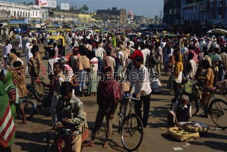 crowds of pilgrims gather outside jagannath