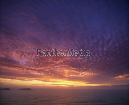 colourful skies at dusk over seascape