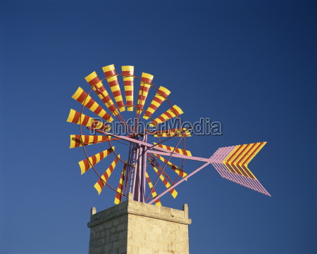 windmill with sails in the colours