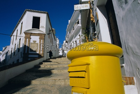 typical street yellow post box and