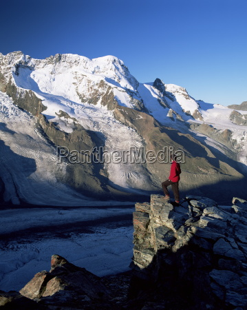hiker and view to the breithorn