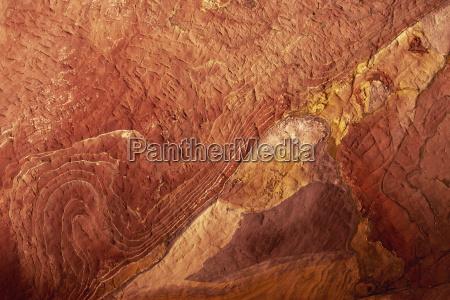 close up of polychromic sandstone rock