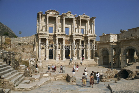 tourists visiting the roman library of