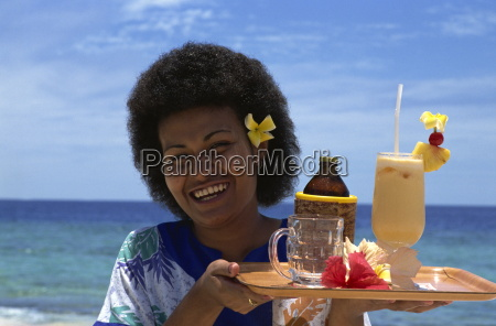 waitress with fruit cocktail navini island