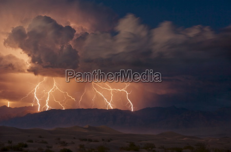 electrical storm with forked lightning over