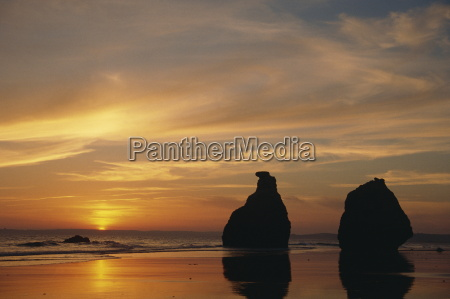 rocks on the coastline silhouetted at