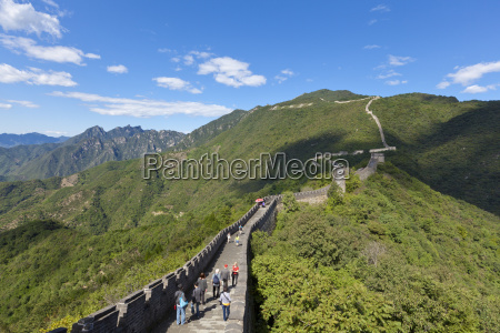 tourists walking on the great wall