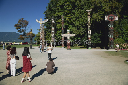 tourists visiting totems at stanley park
