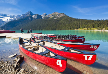 red canoes for hire on lake