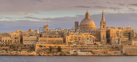 valletta skyline panorama at sunset with